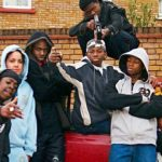 Group of black urban youth with guns