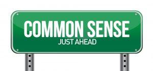 common sense just ahead sign